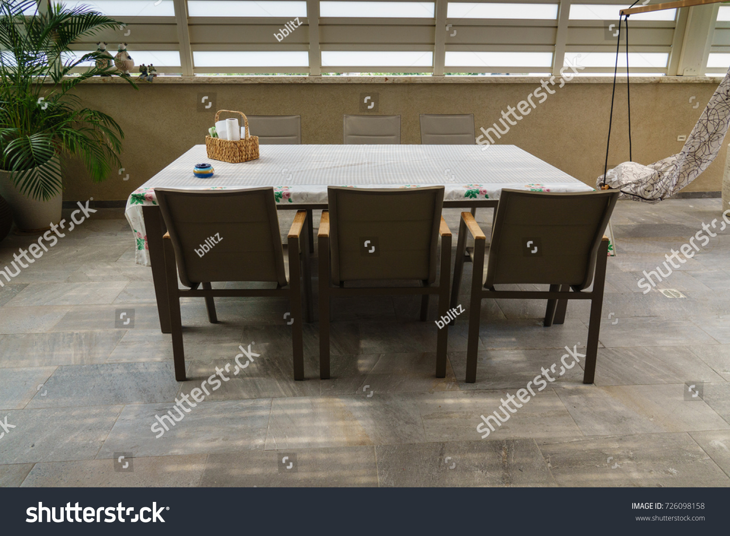 Large patio table with six chairs