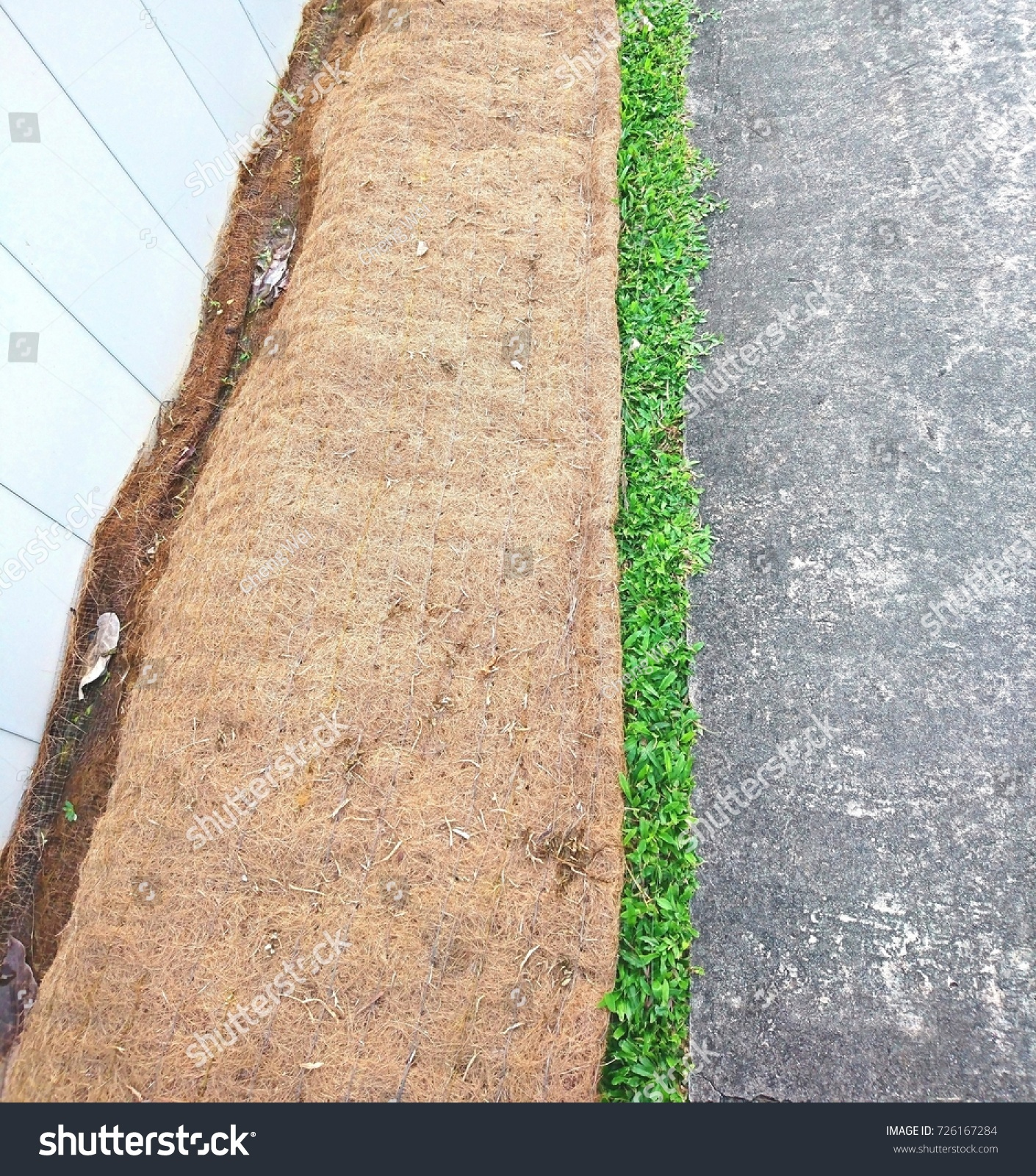 biodegradable soil erosion control blanket placed stock photo (edit