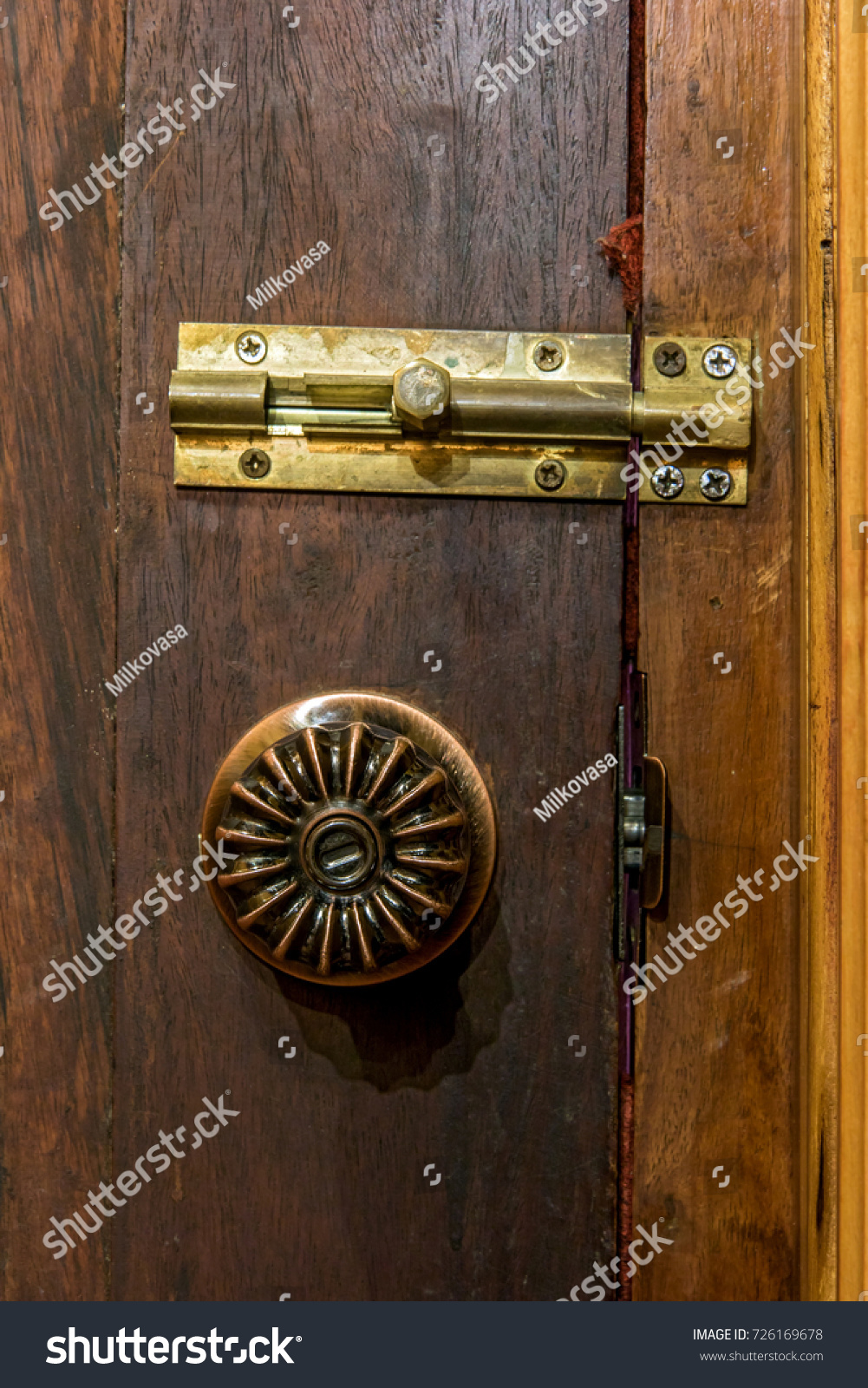 Close Up Old Decorative Door Knob With Latch On Wood Door. Detail Of A Aged
