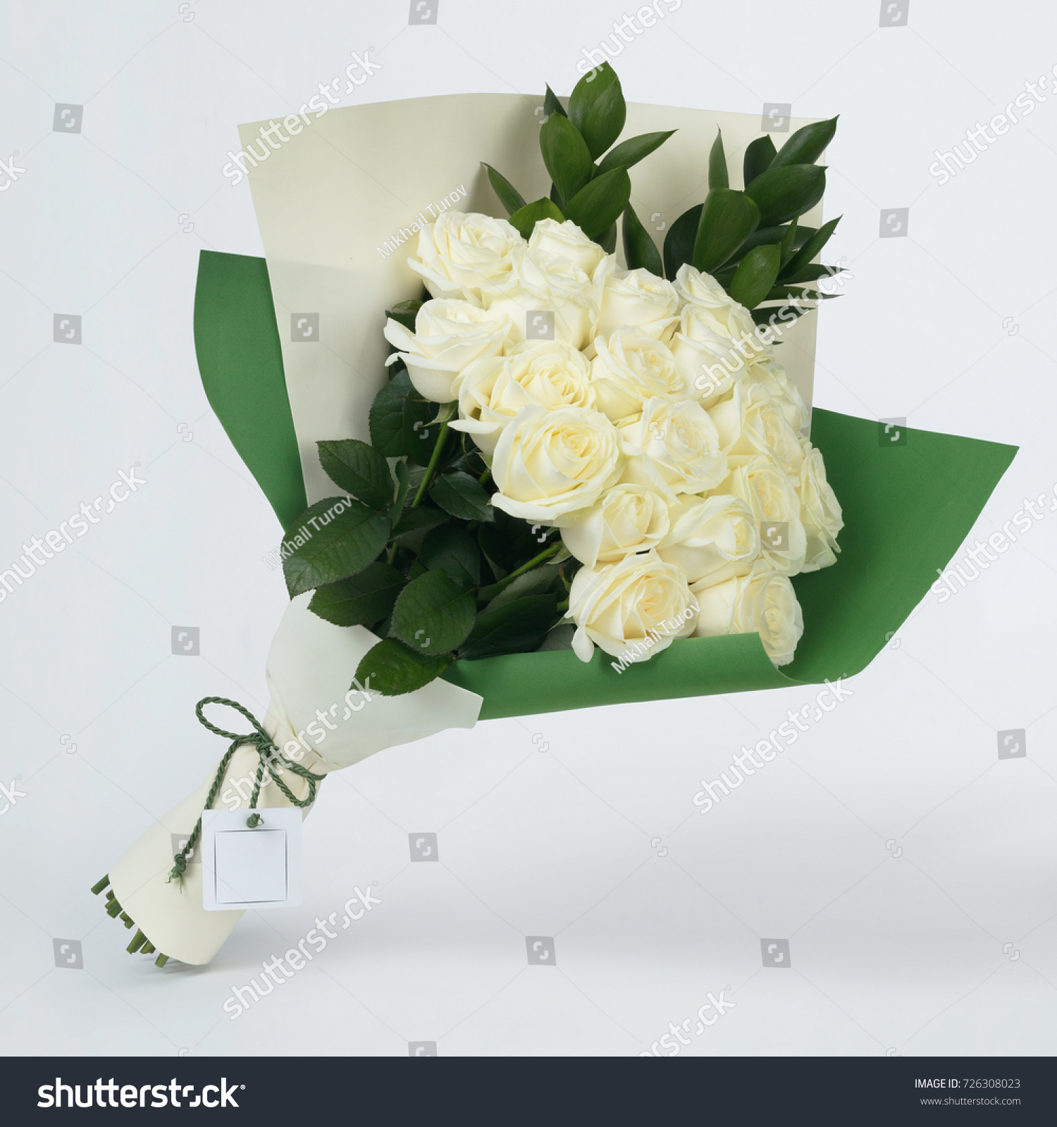 Bouquet beautiful flowers white roses colorful stock photo edit now bouquet of beautiful flowers of white roses in colorful green packaging on a gray background izmirmasajfo