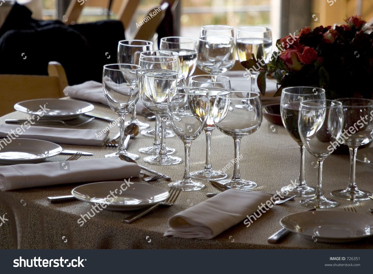 A fancy table setting awaits the guests. Focus is on the forground plate and glasses : fancy table setting - pezcame.com