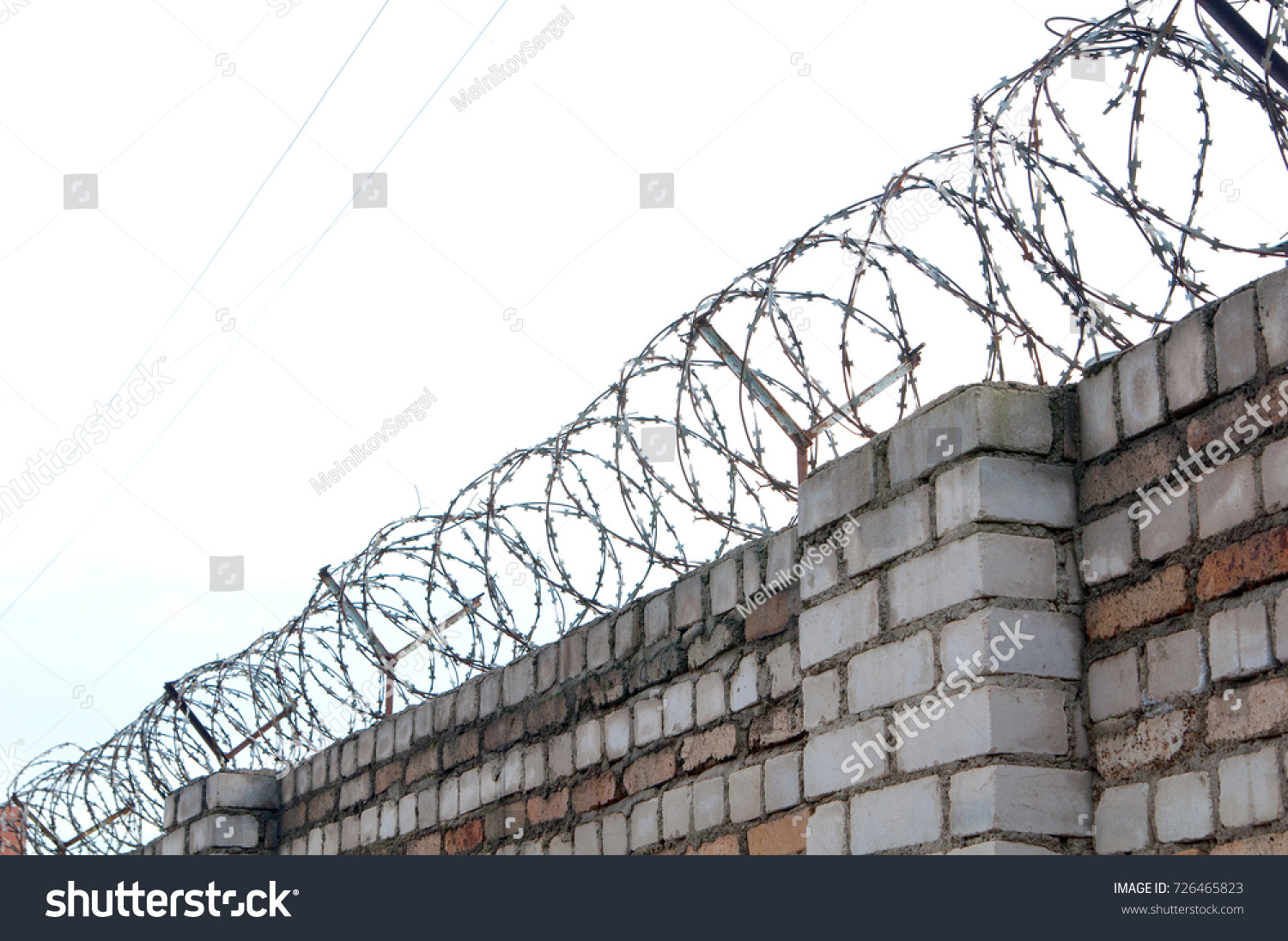 Barbed Wire Coil On Top Old Stock Photo Edit Now 726465823 A Of Brick Wall