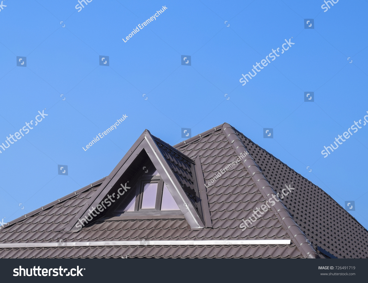 House With Plastic Windows And A Brown Roof Of Corrugated Sheet. Roofing Of  Metal Profile