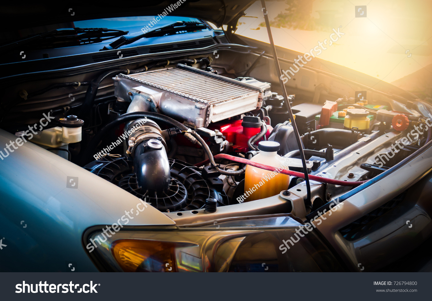 Car crash open hood car mechanic to check condition of damage. See the radiator cooling panel Engine and electronic system for mechanic to check damage thoroughly to repair engine to complete for use. #726794800