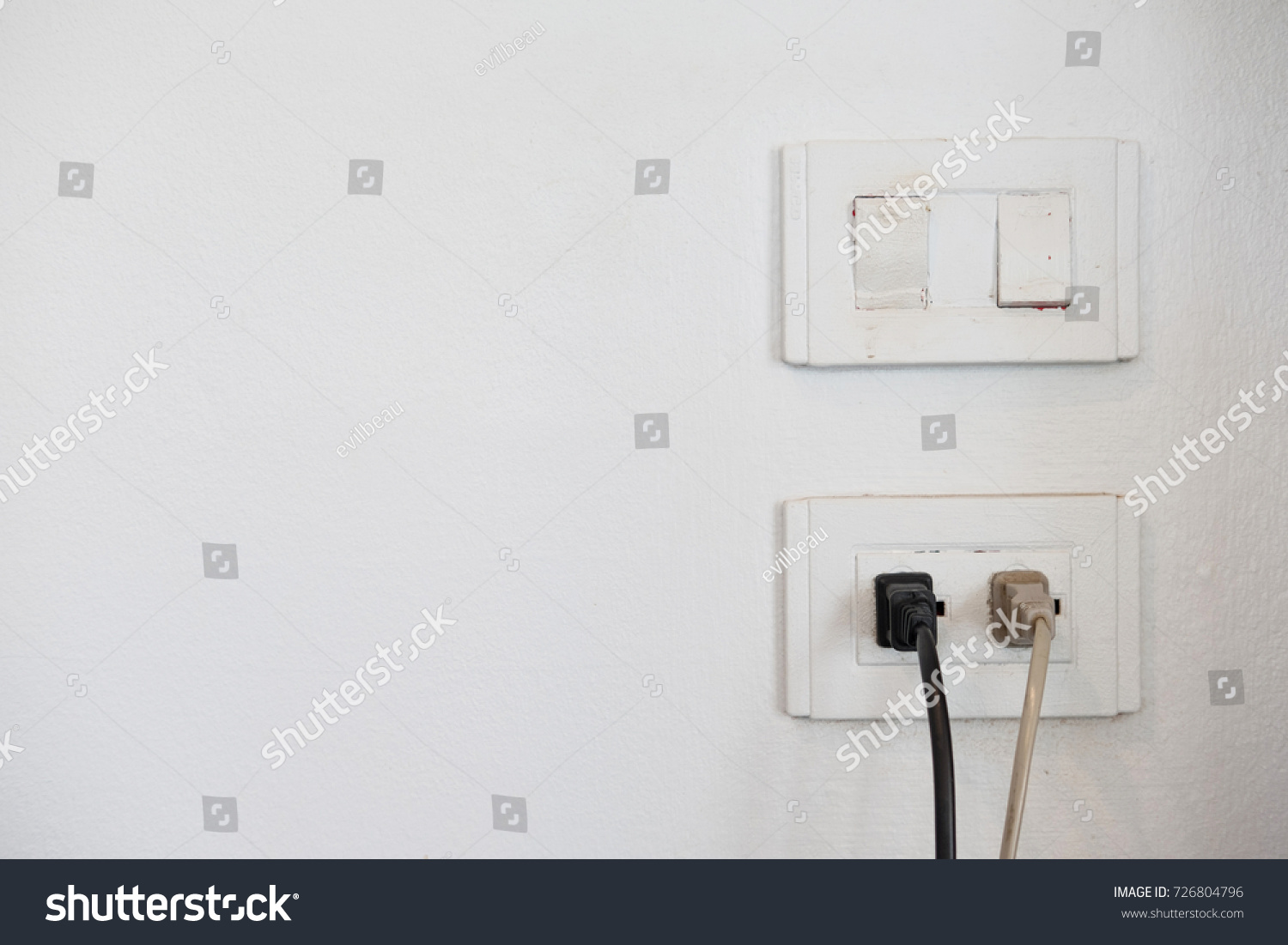 Electric Plug Socket On White Wall Stock Photo 726804796 ...