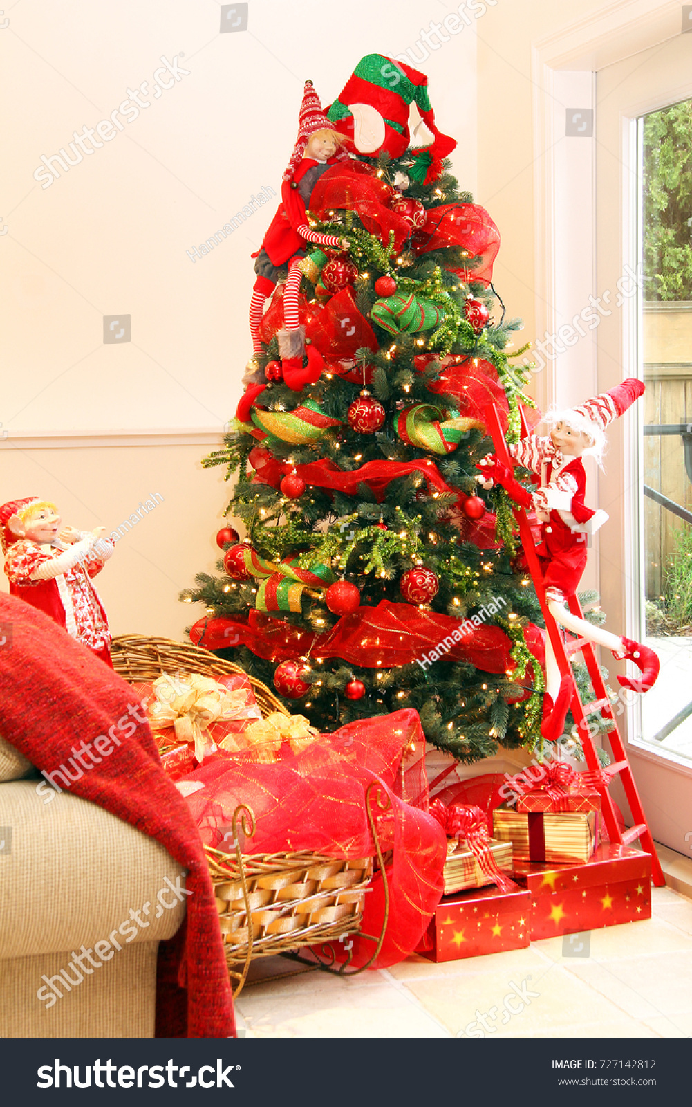 beautiful christmas tree santa hat on stock photo 727142812