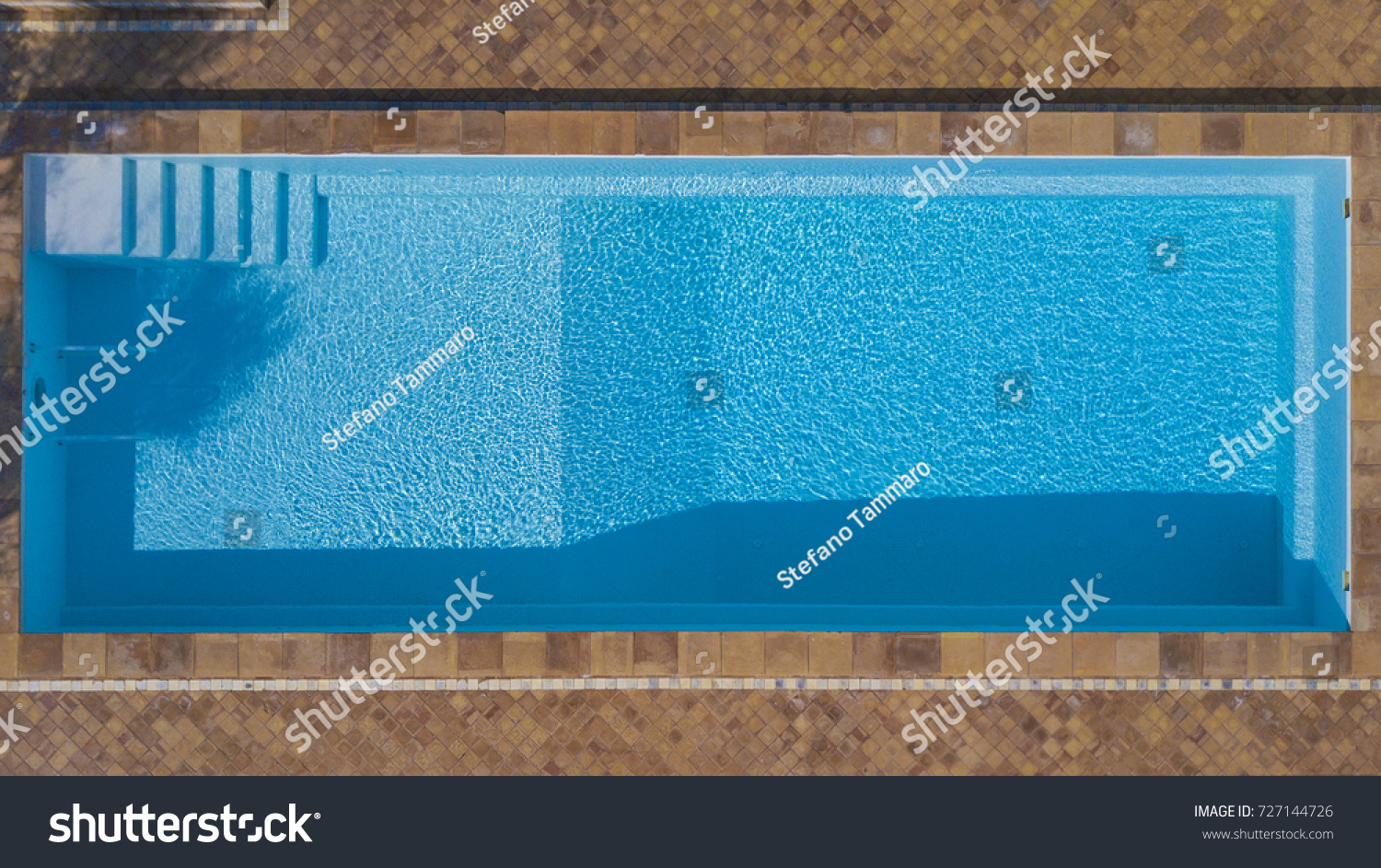 aerial view of a rectangular swimming pool belonging to a large villa the water is - Rectangle Pool Aerial View