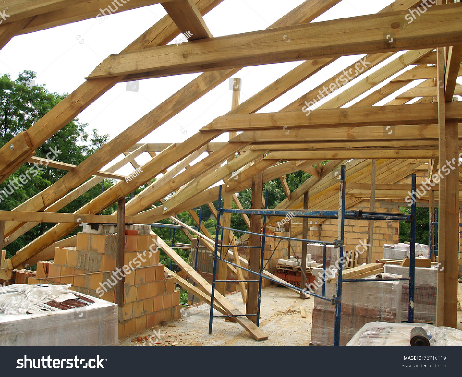 Roof truss install stock photo 72716119 shutterstock for Roof trusses installation