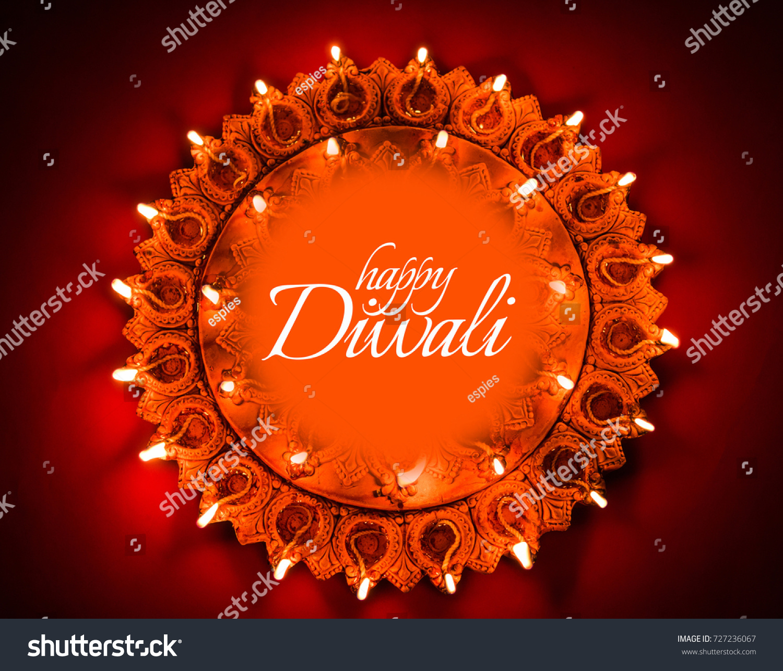 Happy diwali greeting card design using stock photo 727236067 happy diwali greeting card design using beautiful lit diya or clay oil lamps selective focus kristyandbryce Choice Image