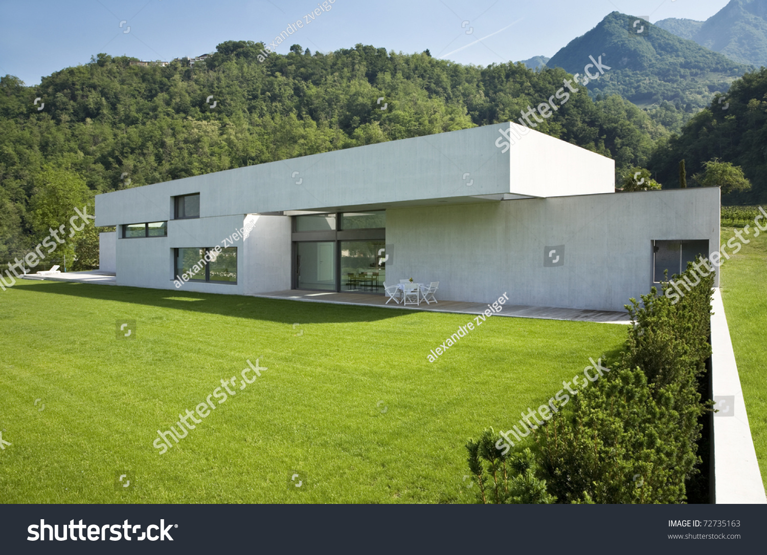 Outdoors Modern House With Green Garden Stock Photo
