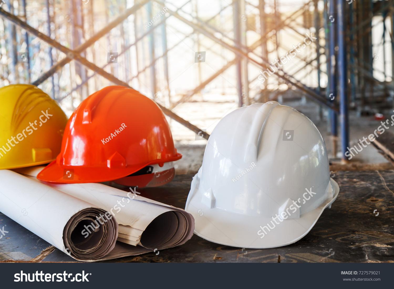 Helmet blueprint on table construction site stock photo 727579021 helmet and blueprint on table in construction site malvernweather Images