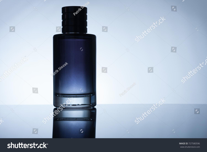 Bottle Perfume On Black Acrylic Sheet Stock Photo (Edit Now