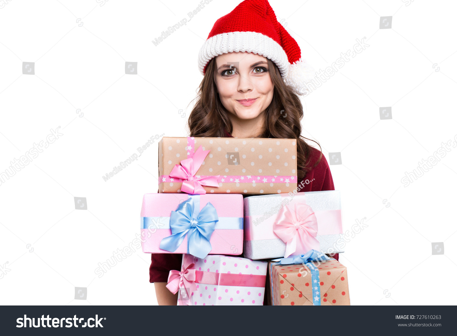 Happy woman in santa hat with gifts isolated. Christmas and holiday ...