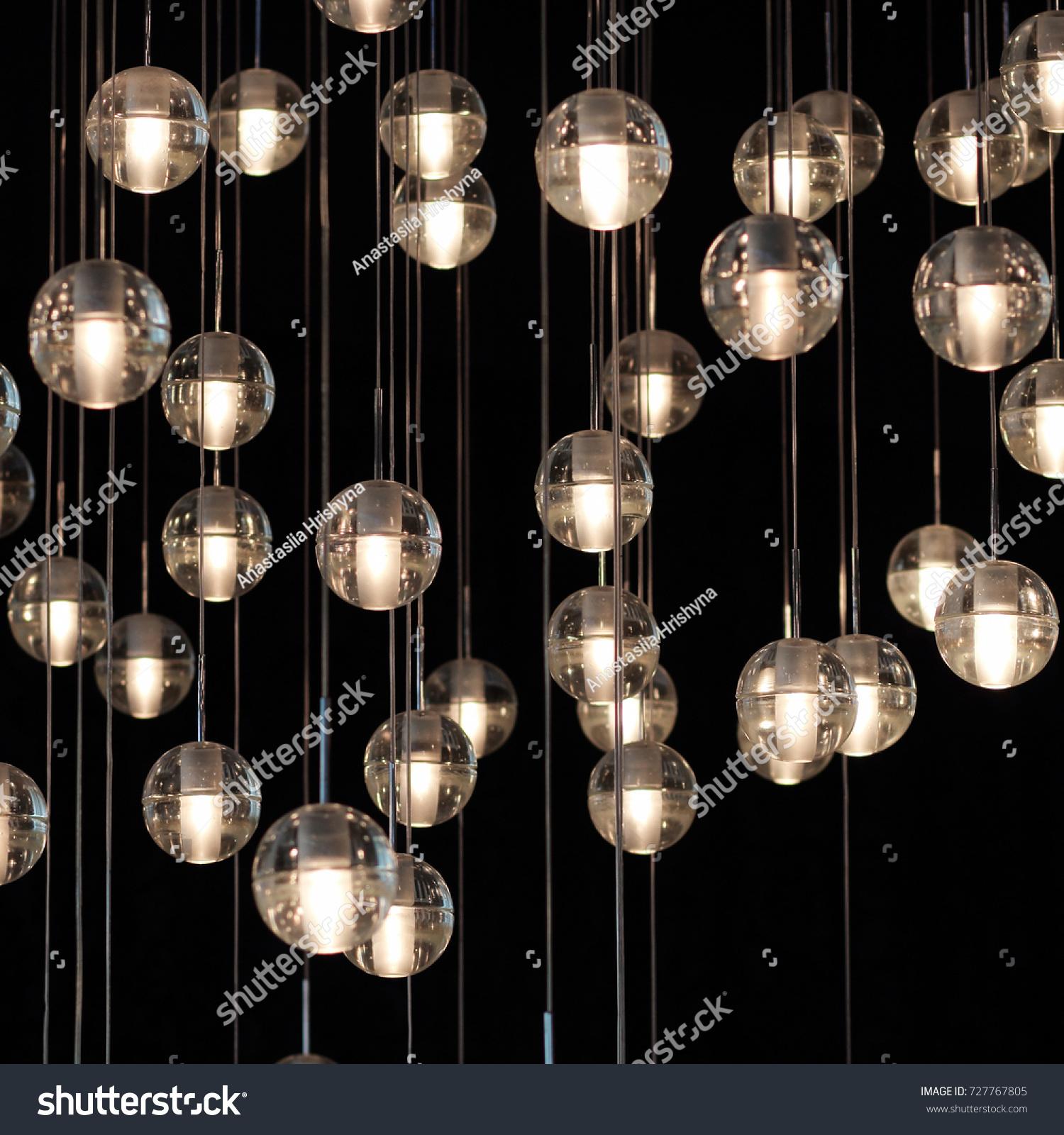 Lighting balls on chandelier lamplight light stock photo royalty lighting balls on the chandelier in the lamplight light bulbs hanging from the ceiling aloadofball Image collections