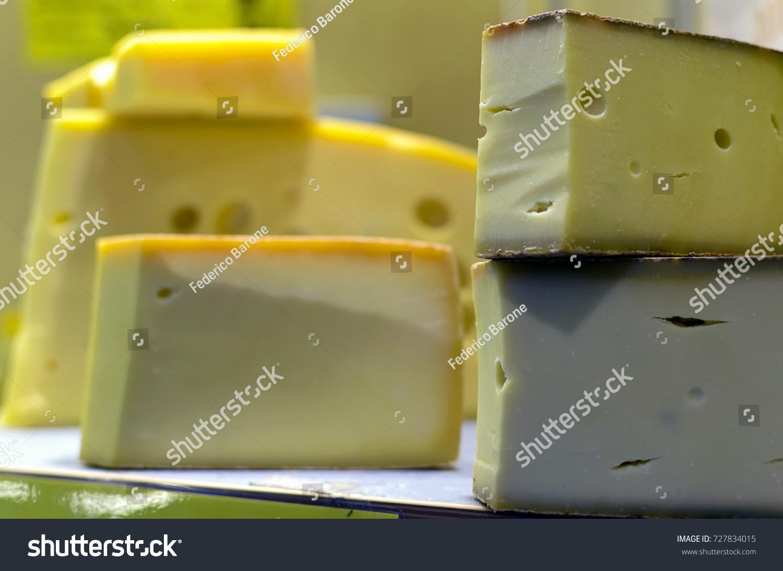 stock-photo-semi-hard-cheeses-at-a-retai
