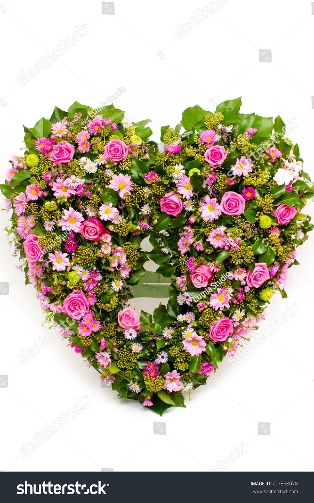 Flower Arrangement Wreath For Funerals In The Shape Of The Heart