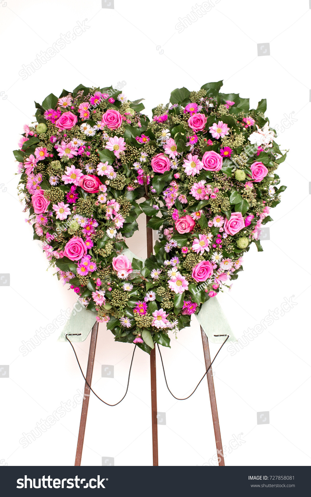 Heart shaped sympathy flowers funeral wreath stock photo 100 legal heart shaped sympathy flowers or funeral wreath flowers pink roses and gerbers and eucalyptus izmirmasajfo