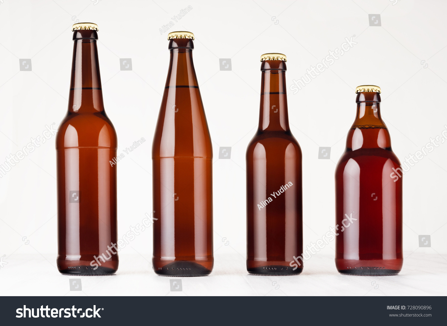 Collection different brown beer bottles, mockup. Template for advertising, design, branding identity on white wood table. #728090896