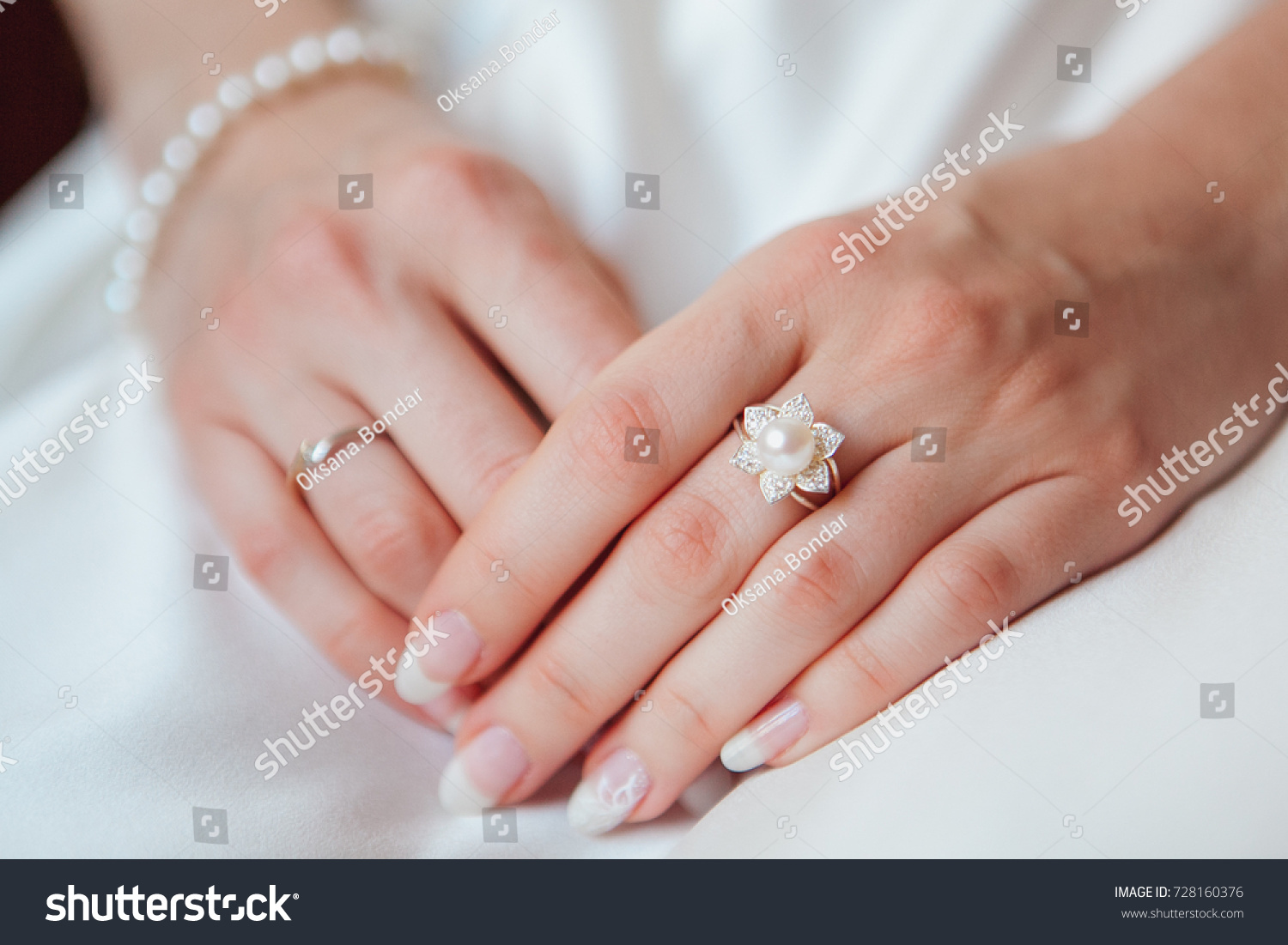 an image of situation of inserting engagement ring into a finger ...