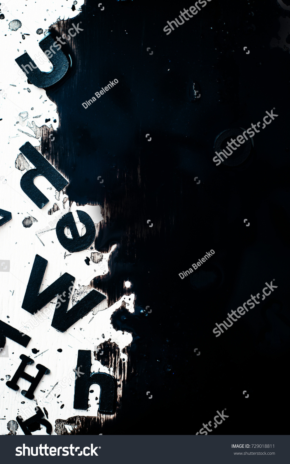 scattered letters blurring spilled ink creative stock photo (edit