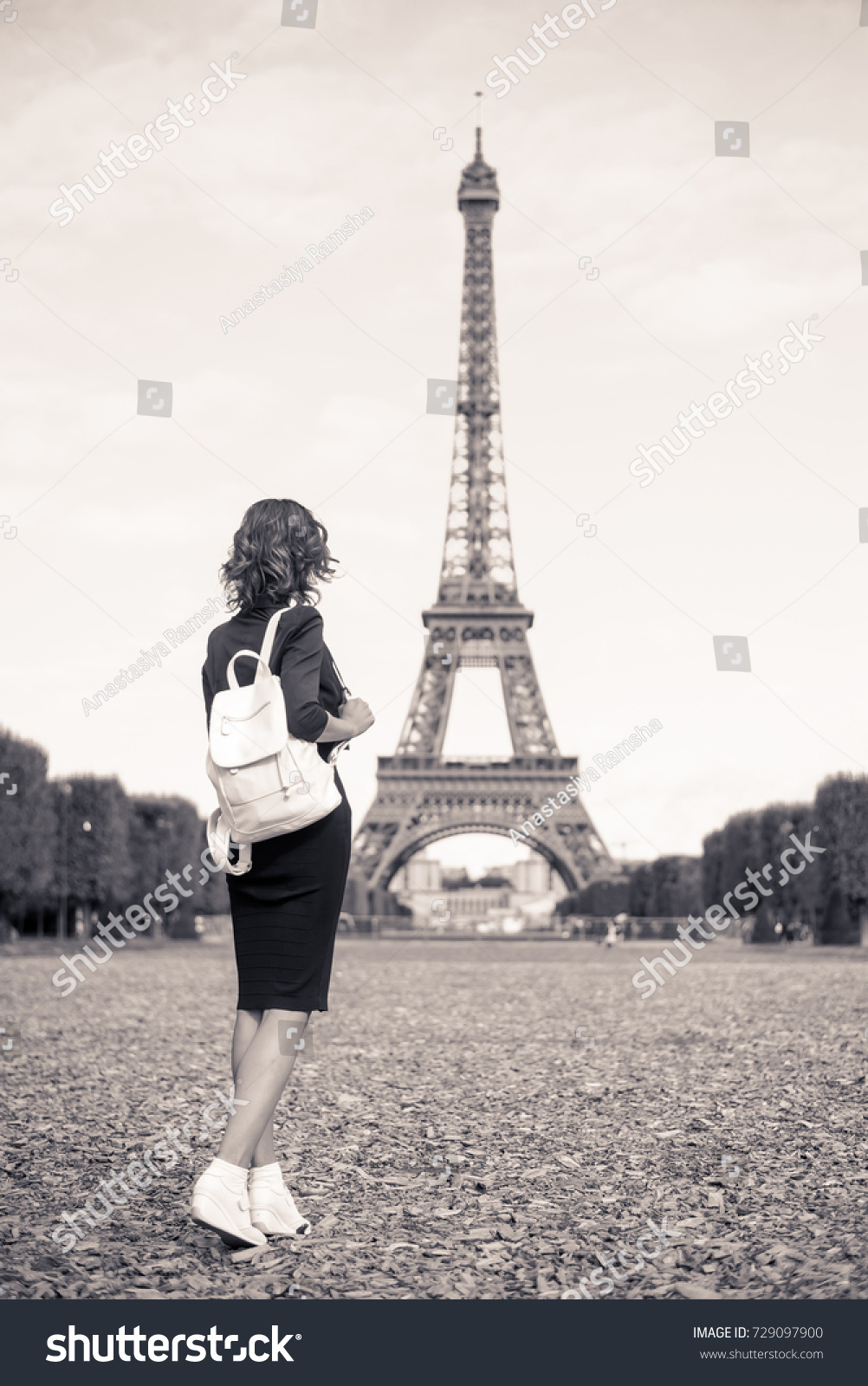 Girl alone near the eiffel tower in paris black and white picture