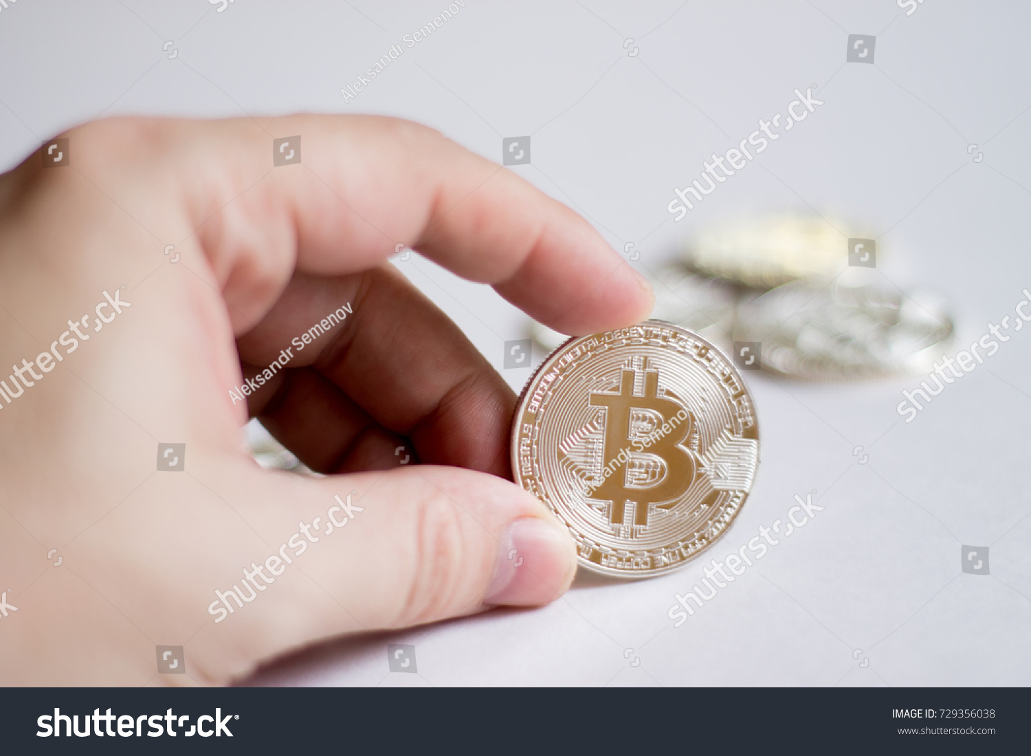 Bitcoins In The Hand A Concept From Coins Of Cryptocurrency On Light Background