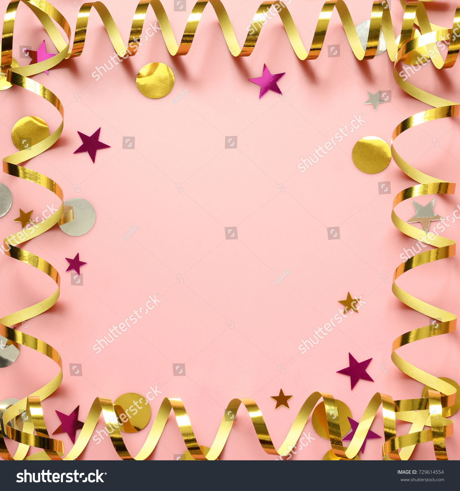 golden pink silver background with party decoration serpentine and confetti birthday