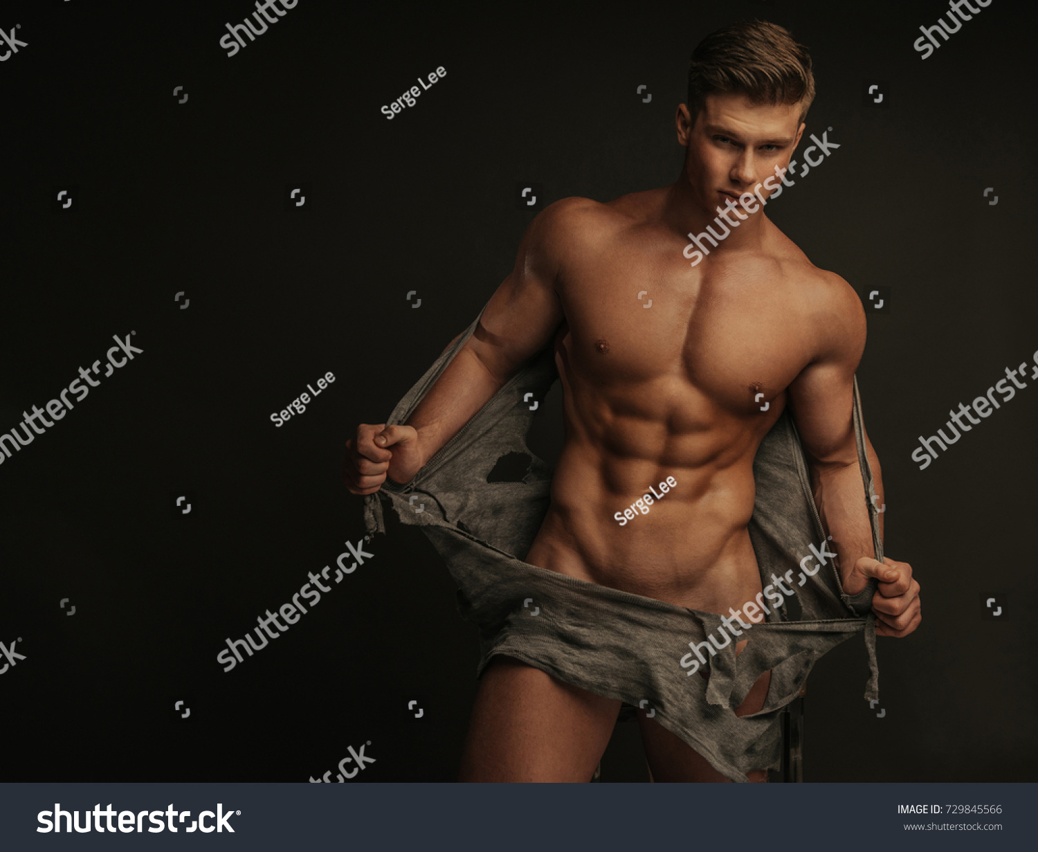 muscular naked man tearing off his stock photo (royalty free