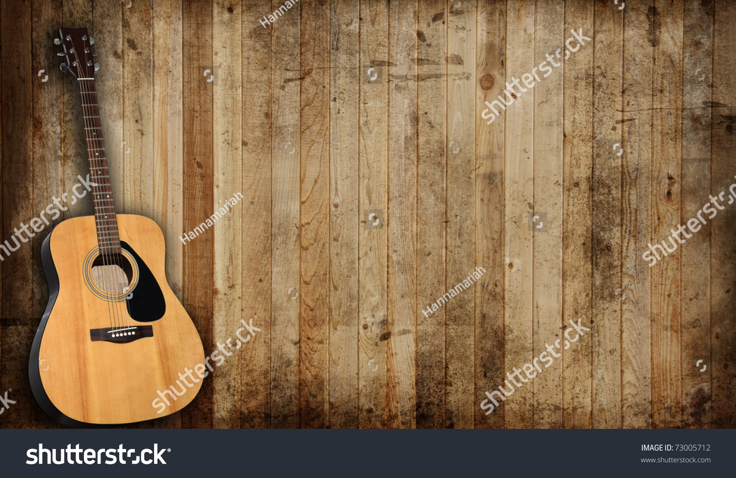 Acoustic Guitar Against Old Barn Background Stock Photo