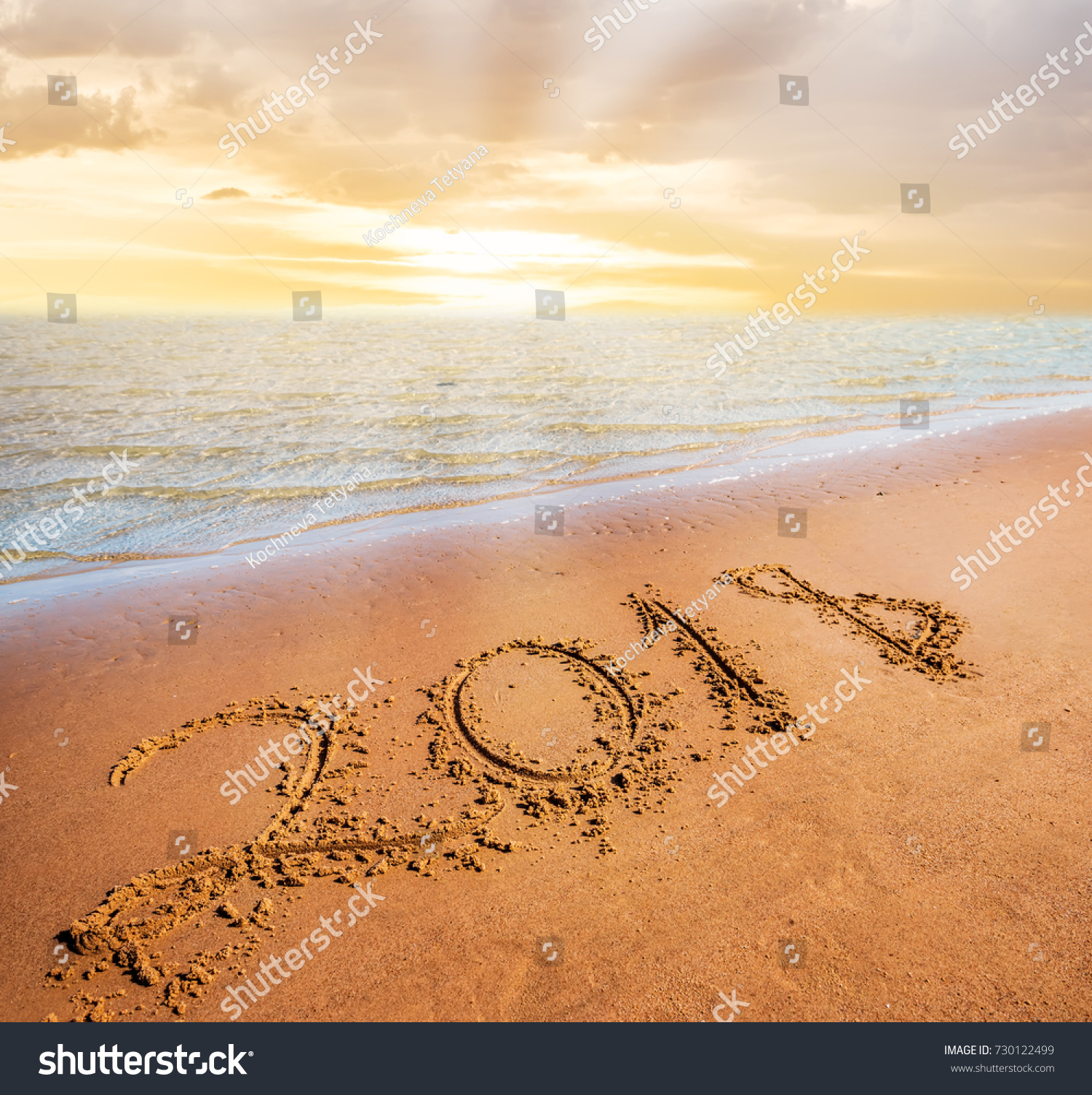 happy new year 2018 coming concept digits on sand beach