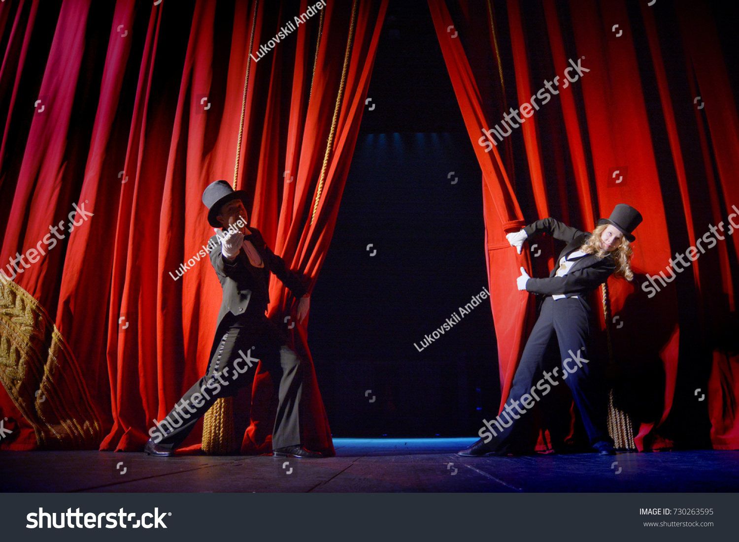 the actor opens a theater curtain #730263595
