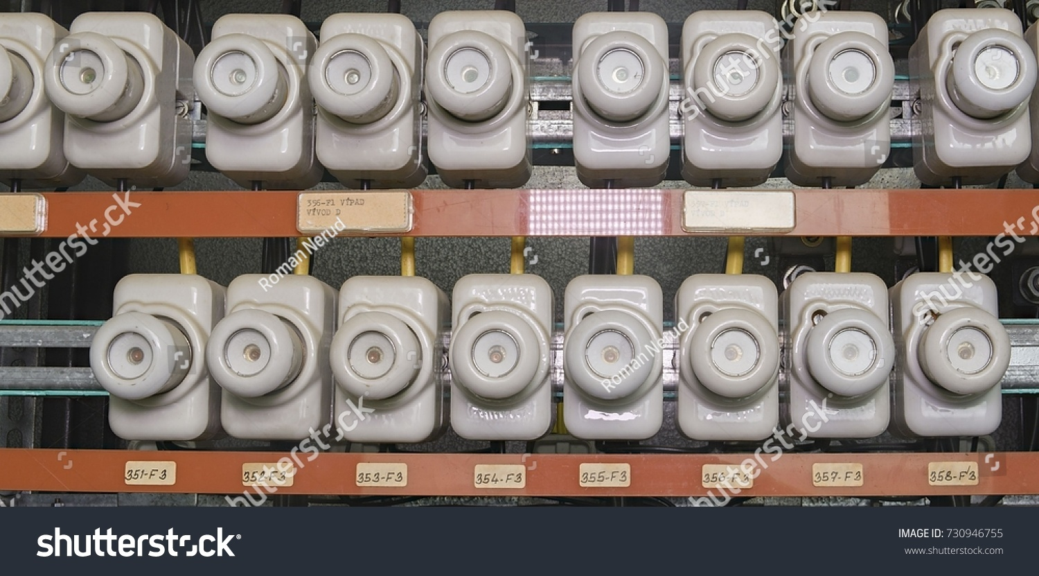 old electrical fuse box with porcelain fuses