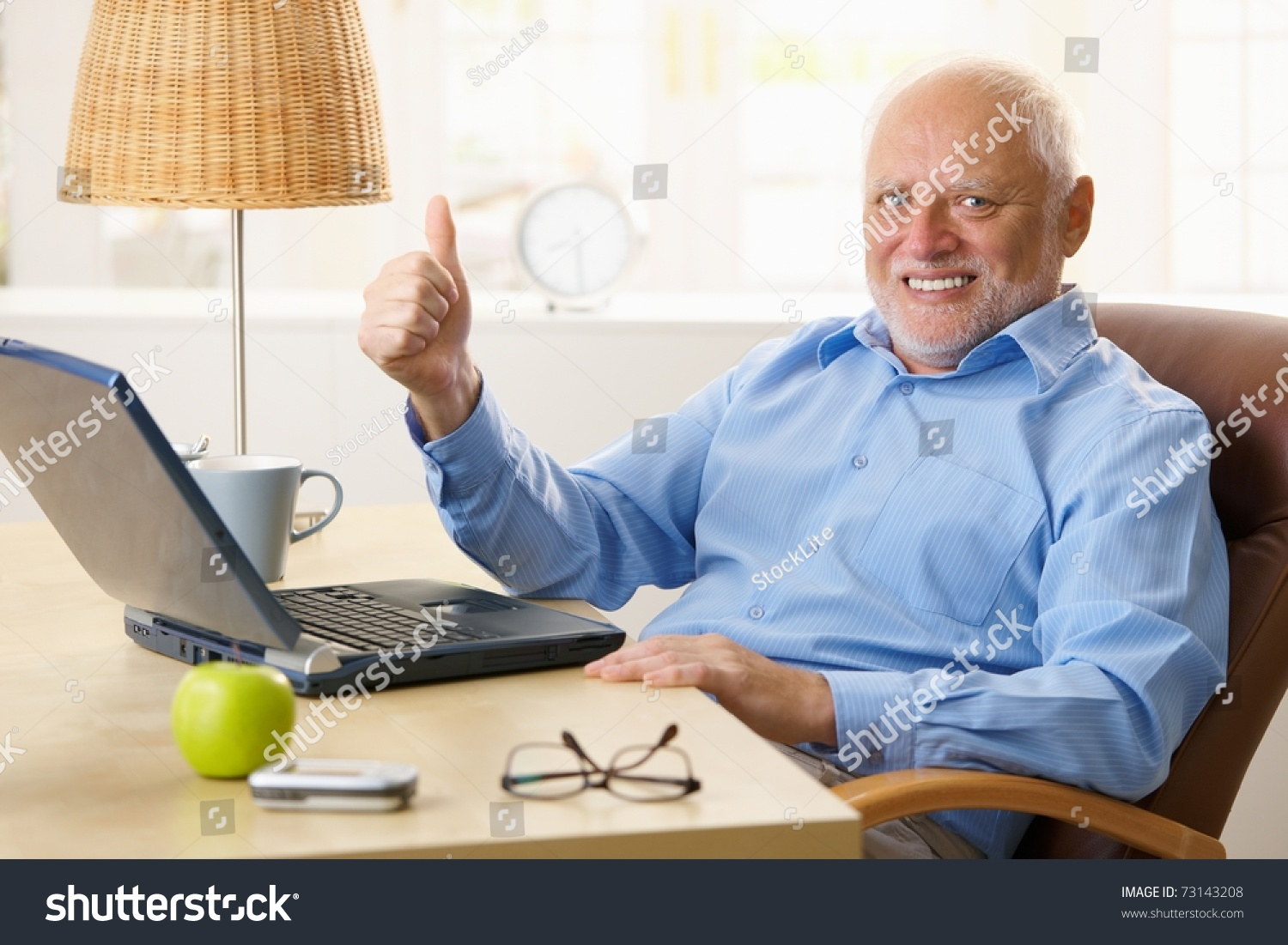 stock-photo-happy-senior-man-giving-thum