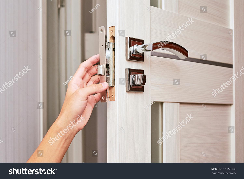 handyman repair the door lock in the room Man fixing lock with screwdriver Close & Handyman Repair Door Lock Room Man Stock Photo 731452300 ...