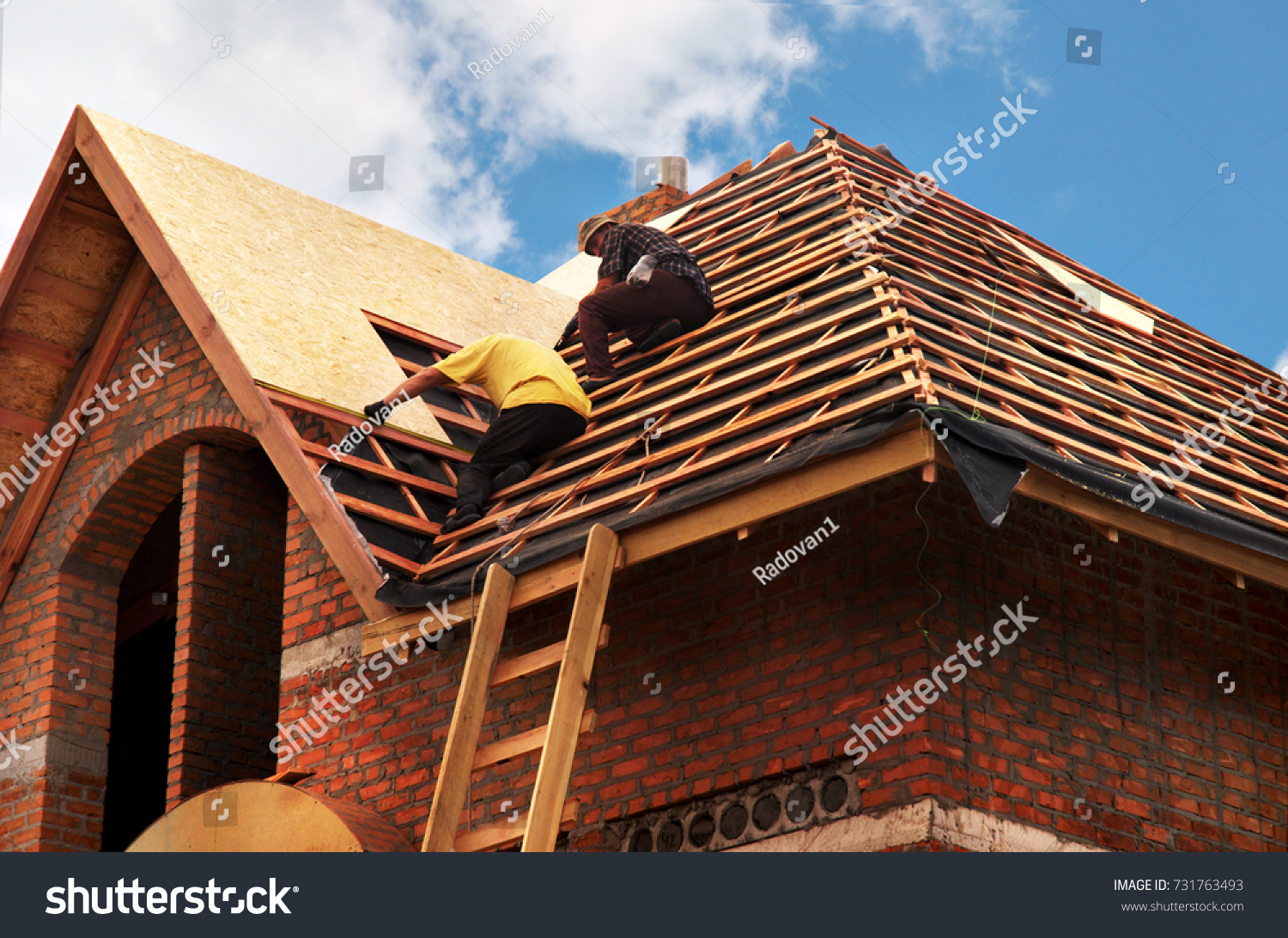 Roofing Contractors Installing House Roof Board for Asphalt Shingles. Roofing Contractor. Roofing Construction. Roof Repair. #731763493