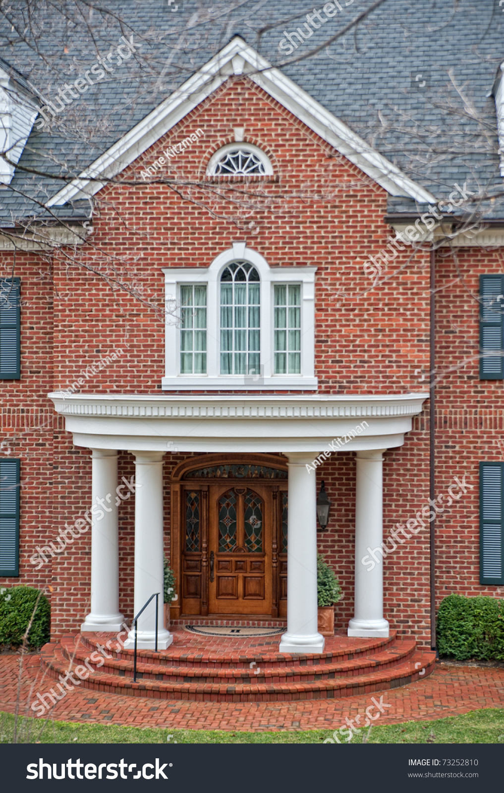 Stately White Columns Decorate Front Entry Stock Photo