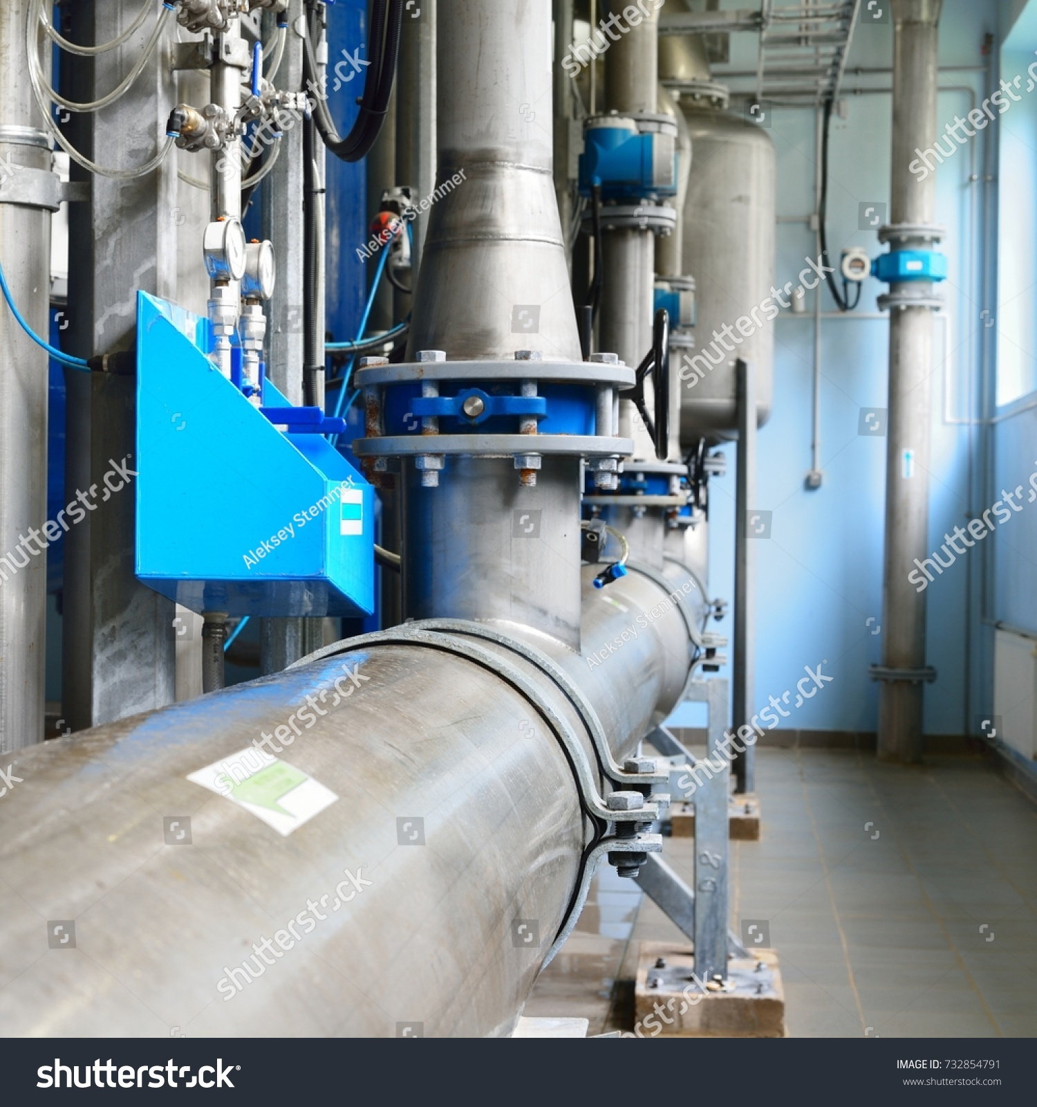 Large industrial water treatment and boiler room. Shiny steel metal ...