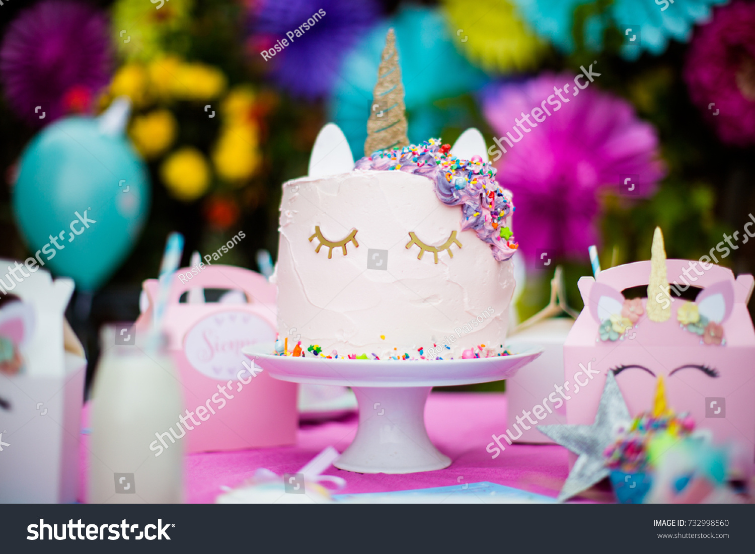 Unicorn Themed Birthday Cake In Pink With Sprinkles