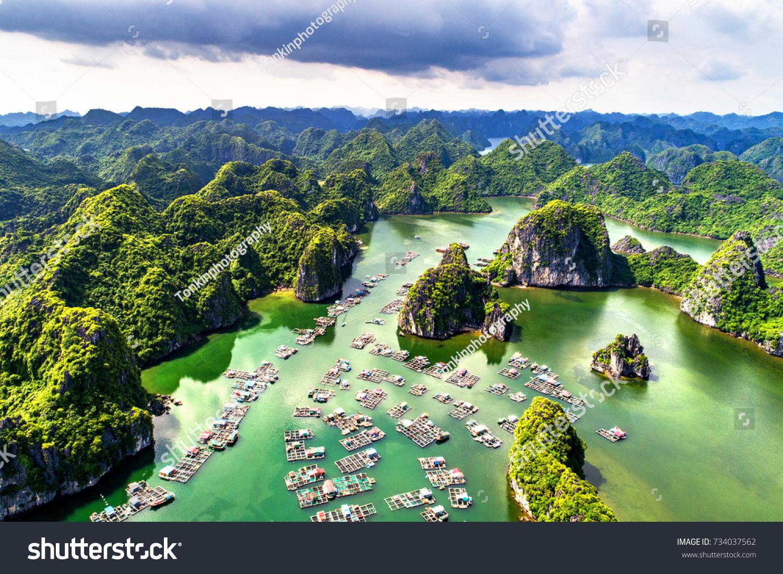 "Floating fishing village and rock island in "" Lan Ha "" Bay, Vietnam, Southeast Asia. UNESCO World Heritage Site. Landscape. Popular landmark, famous destination of Vietnam. Near "" Ha Long "" bay #734037562"