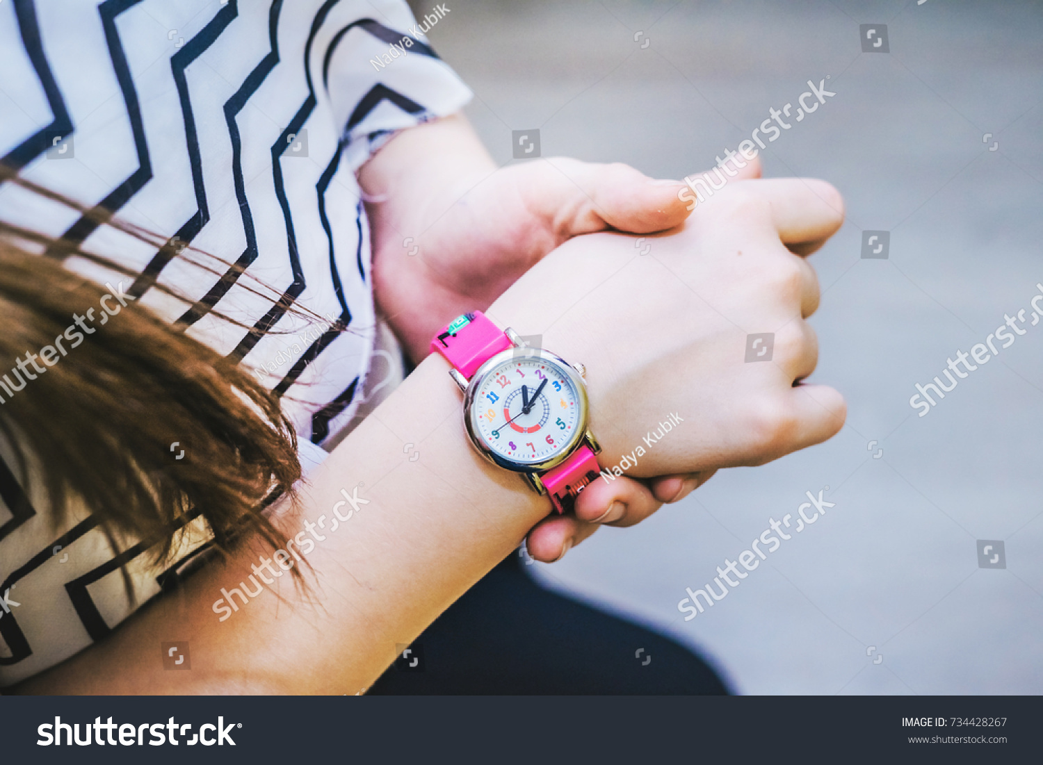 Girl Looks Time On Her Pink Stock Photo 734428267 - Shutterstock