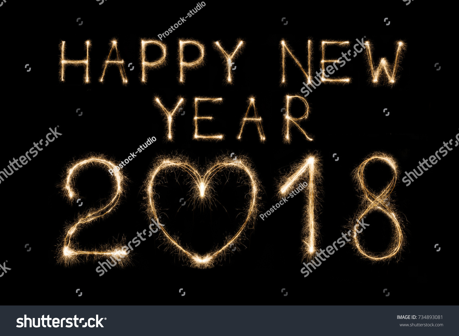 happy 2018 new year written with sparkler fireworks on black background with heart shape love