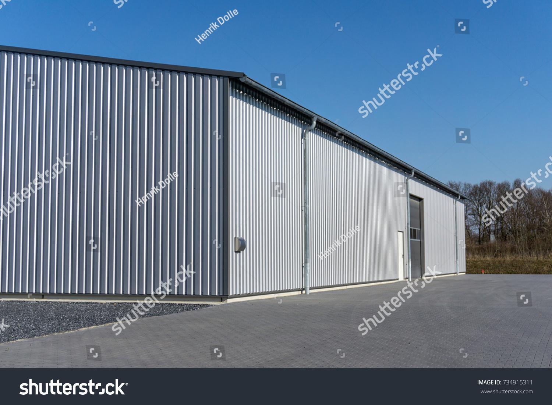 modern metal garage door. Modern Gray Warehouse With Sheet Metal Cladding And Large Roller Door Garage