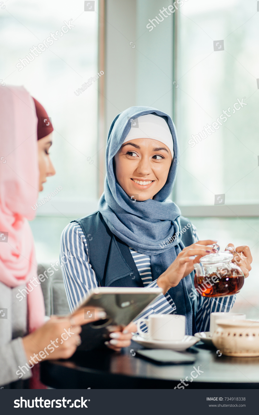 Female Muslim College Student Using Tablet Stock Photo (Royalty Free ...