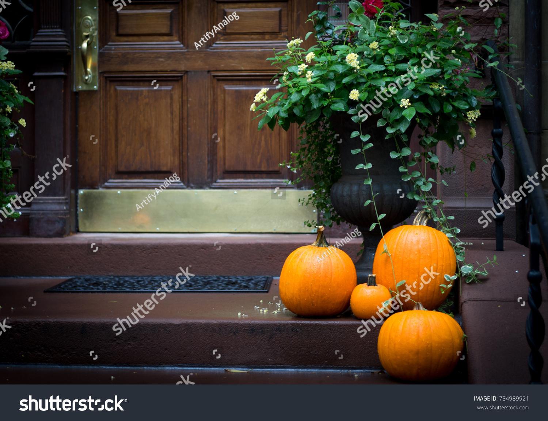 Tasteful pumpkins on doorstep for Halloween trick or treat & Tasteful Pumpkins On Doorstep Halloween Trick Stock Photo 734989921 ...