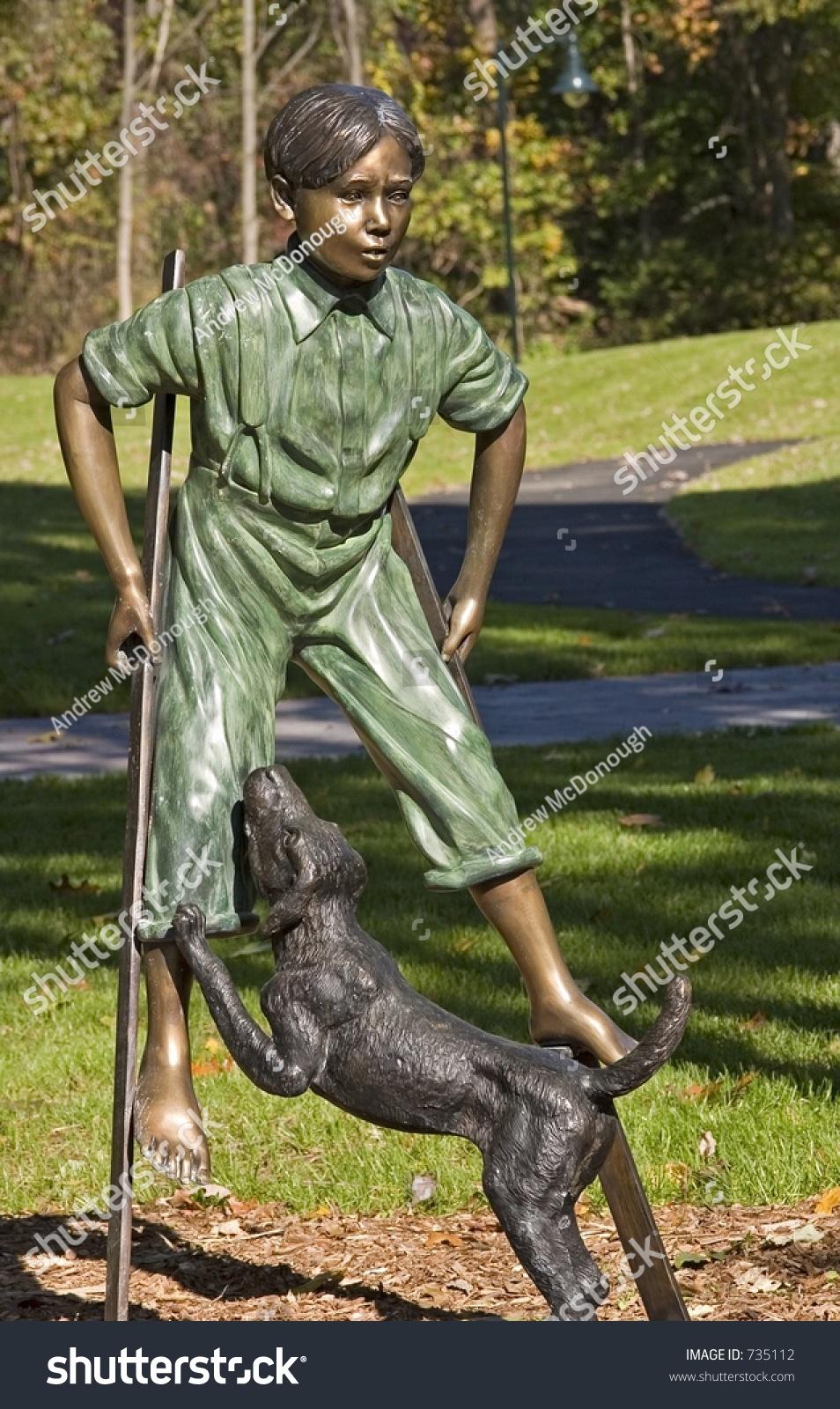 Here, boy.   Statue, Greek statue, Dogs