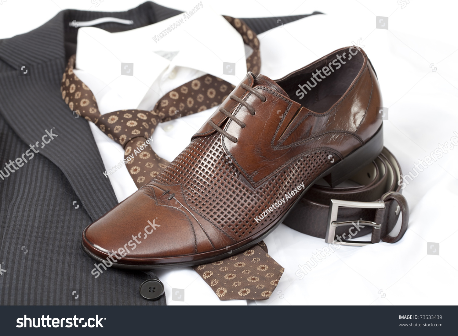 formal wear with belt and brown shoes stock photo 73533439