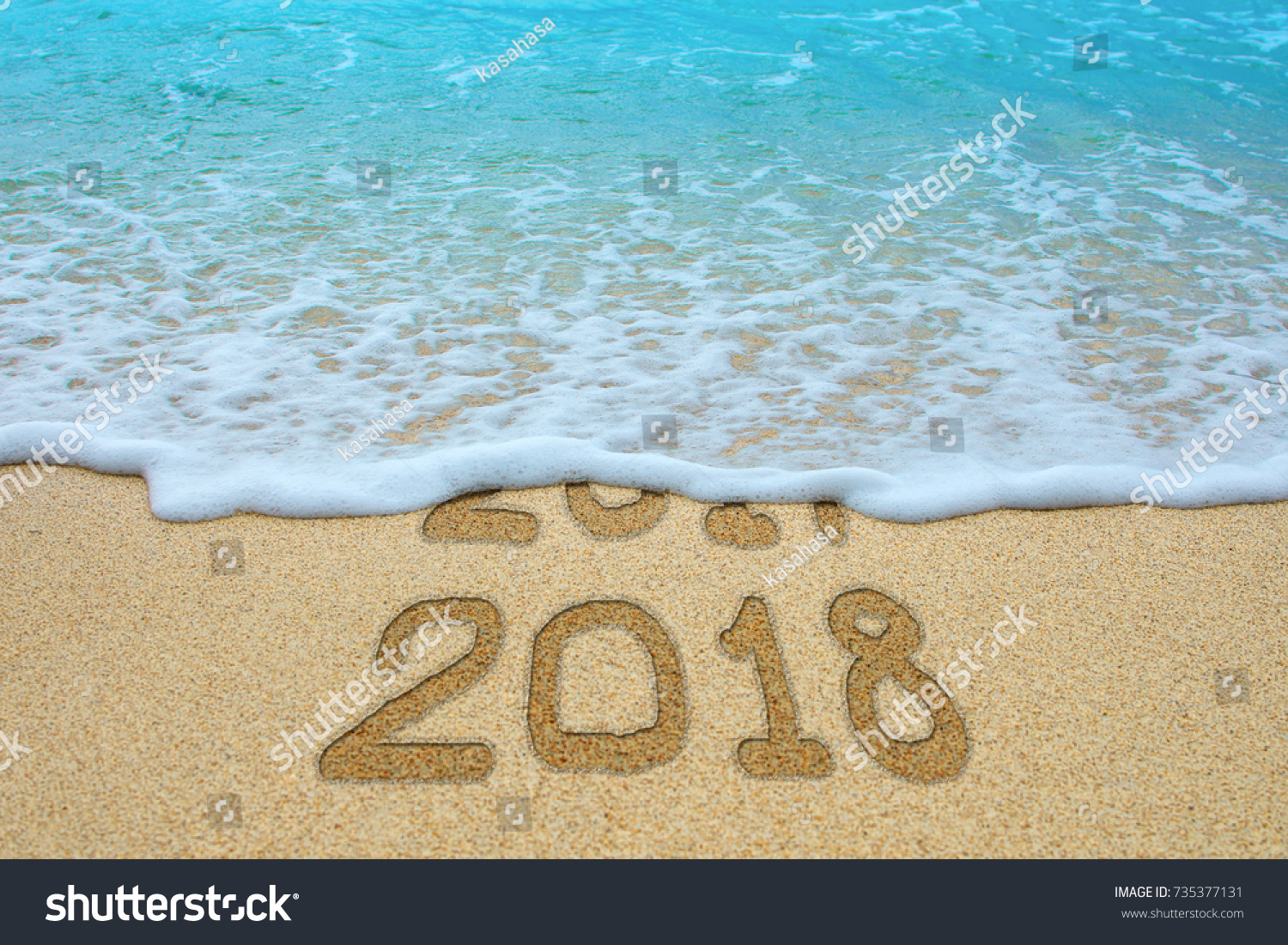 2017 And 2018 Written On Sandy Beach, The Wave Is Covering 2017. New Year