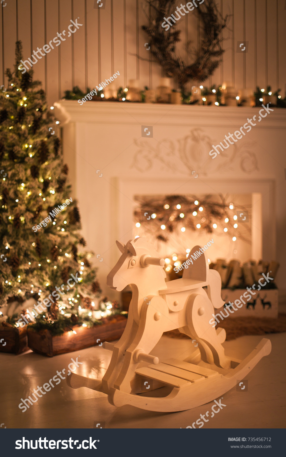 rocking horse on the background of christmas decorations