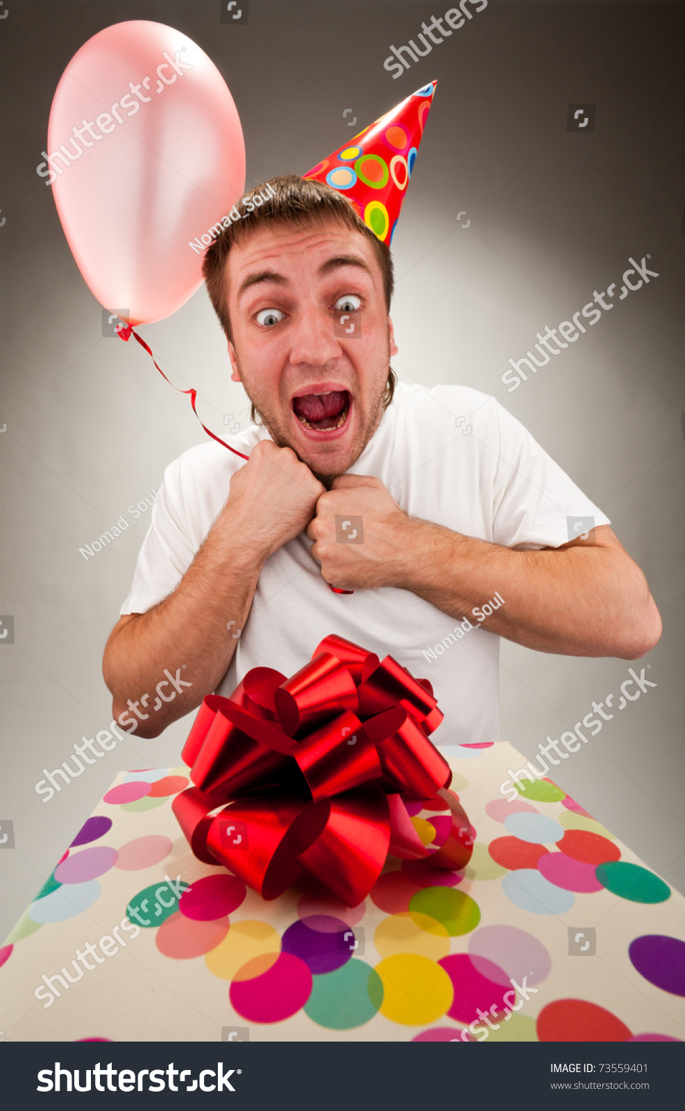Happy Young Man Celebrating Birthday With Gift And Balloon