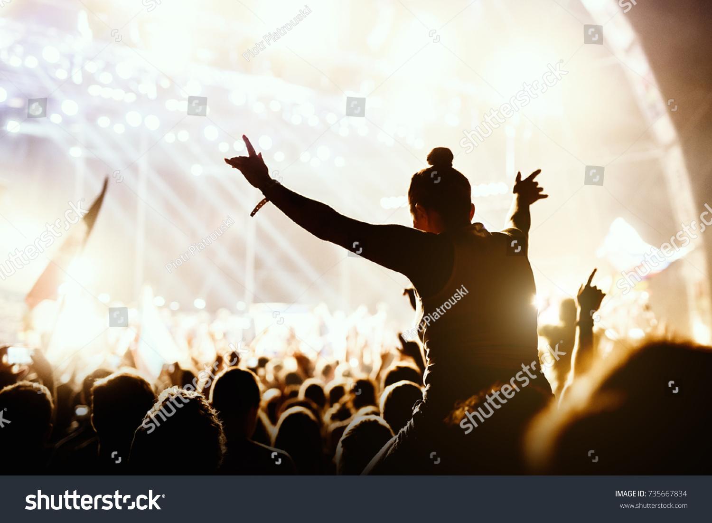 Girl enjoying the outdoor music festival concert. #735667834